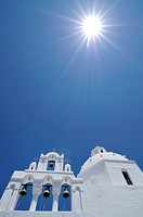White Greek church with a bell tower and a sun star, Karterados, Santorini, Cyclades, Greece, Europe