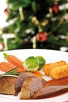 Roast goose-breast with gravy, potato croquettes, sprouts and carrots