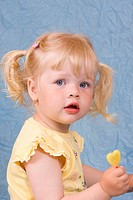Blonde little girl, 2 years, with lollipop