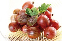 Red gooseberries on a glass plate