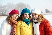Three teenage girls in a snow-covered landscape
