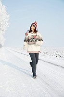 Woman jogging in a wintery landscape