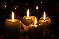 Four burning candles on the 4th Advent Sunday