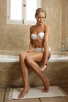 Woman, young, underwear, sitting, bathtub edge, lower legs, depilate, ,