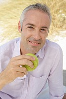 Man, smiling, beach, sitting, apple, eating, portrait, ,