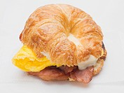 Croissant filled with bacon, scrambled egg and cheese