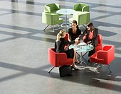 Three businesswomen having a meeting in office building (thumbnail)
