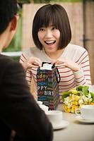 Boyfriend giving Asian girlfriend birthday gifts