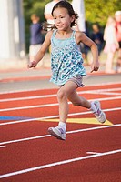 Asian girl running on race track