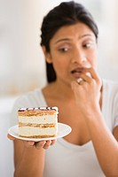 Indian woman unsure about eating cake