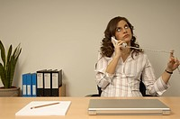 bored secretary having telephone conversation
