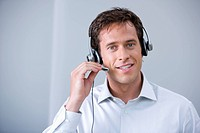 portrait of male call center agent with headset