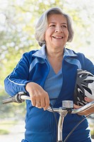 Hispanic woman on bicycle