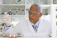 African scientist performing analysis in laboratory