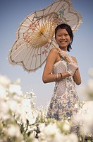 Portrait of Asian woman holding parasol