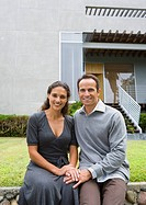 Portrait of Hispanic couple in front of house (thumbnail)