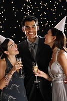 Hispanic friends drinking champagne on New Year´s Eve
