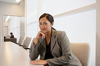 Portrait of Asian businesswoman at conference table