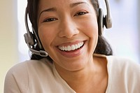 Pacific Islander businesswoman wearing headset