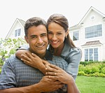 Hispanic couple in front of house
