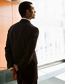 Hispanic businessman waiting