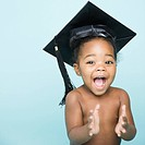 Portrait of African American girl wearing mortarboard