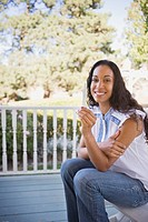 Mixed race woman holding pregnancy test