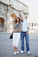 Tourist couple hugging near ruins
