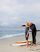 Father and son at beach with surfboards