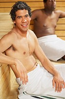 Two multi_ethnic men relaxing in sauna