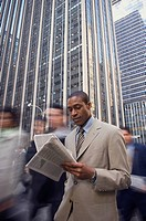 African American businessman reading newspaper