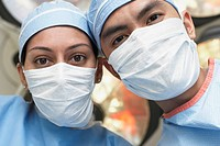 Asian medical professionals wearing surgical masks