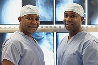 African American medical professionals in front of x_rays