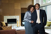 African couple standing in modern living room