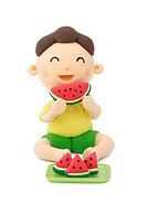 Illustration of a boy eating the watermelon