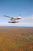 Flying over East counties in seaplane at fall, Quebec, Canada