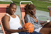 Young Man Holding Basketball Relaxing with Friend Portrait