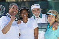 Two couples playing tennis portrait