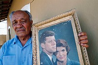 Former emigrate in US back home showing a portrait of Kennedy, Fogo, Cape Verde
