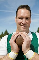 Male shot putter gripping shot portrait