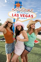 Women posing in front of Las Vegas welcome sign Nevada USA