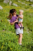 Mother and son standing in meadow in the Wasatch mountains near Alta in Utah USA