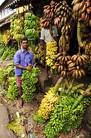 A man working at a banana shop  Kollam, Kerala, India