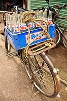 A bicycle loaded with a case of Pepsi bottles  Kollam, Kerala, India