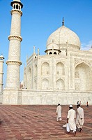 Muslim men walking infront of the Taj Mahal  Agra, India