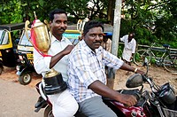 Men transporting trophys for the Nehru Snake boat race  Alappuzha Alleppey, Kerala, India