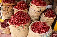 Bags of dried chilies at the market in Kollam, Kerala, India