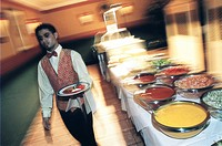 Waiter serving food