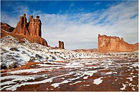 A snow storm leaves the Three Gossips, Sheep Rock and the Tower of Babel coated in a layer of whiter powder in Arches National Park, Utah