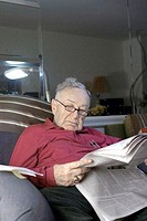 Mr Dov Sachter sitting on sofa He is Romanian born and Jewish He is 85 years old Photo taken September, 2006 in his Riverdale apartment in the Bronx